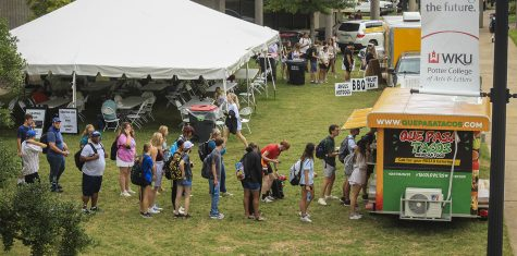 WKU students wait in long lines at Que Pasa Tacos food truck at Local Restaurant Row for lunch on Friday, Sept. 17, 2021.
