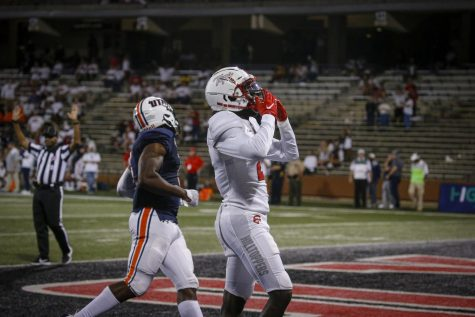 WKU wide receiver Craig Burt Jr. (2) celebrates after scoring a touchdown during the Hilltoppers season-opener. The Hilltoppers defeated The Skyhawks 59-21 on Sept. 2, 2021 at Houchens-Smith Stadium.