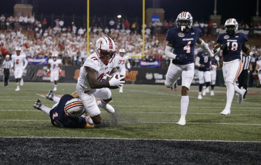 WKU+wide+receiver+Malachi+Corley+%2811%29+attempts+to+score+during+the+Hilltoppers+season-opening+59-21+win+over+UT+Martin+on+Sept.+2%2C+2021.+