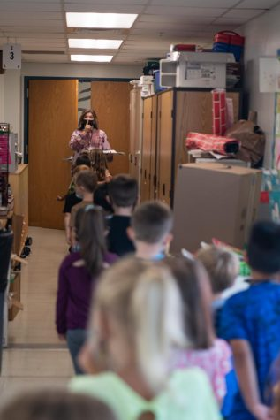 Art Education Student Jaci Bolin serves as a substitute art teacher at Rich Pond Elementary school in Bowling Green, Kentucky.  Here, Jaci instructs her kindergarteners to line up quietly as class ends.