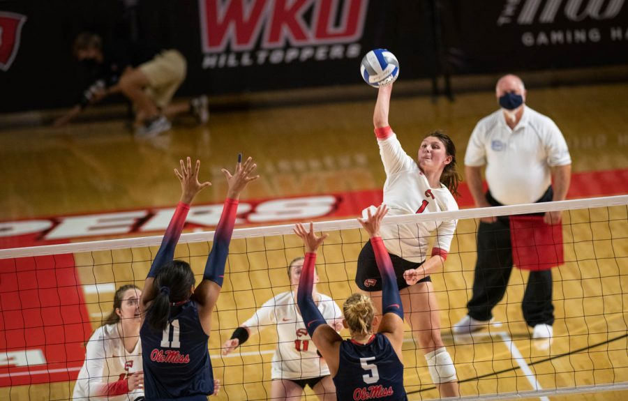 WKU Hilltopper junior outside hitter Paige Briggs (1) jumps for a spike against Ole Miss Rebel sophomore middle blocker Sasha Ratliff (11) and sophomore Samantha Schnitta (5) during a volleyball game at Diddle Arena on the evening of Sept. 10, 2021.