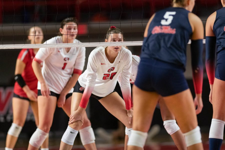 WKU Hilltoppers senior middle hitter Katie Isenbarger (20) pauses for a moment at the net during the volleyball game against the Ole Miss Rebels on the evening of Sept. 10, 2021, at Diddle Arena.