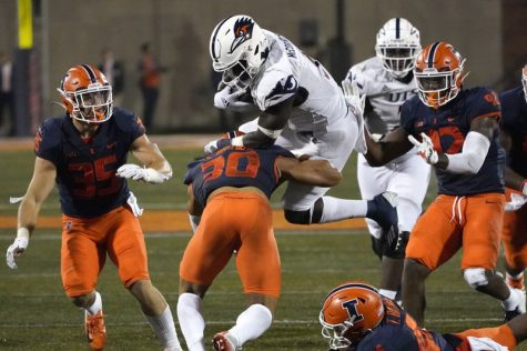 UTSA running back Sincere McCormick is upended by Illinois defensive back Sydney Brown during the first half Saturday in Champaign, Illinois. UTSA won 37-30.