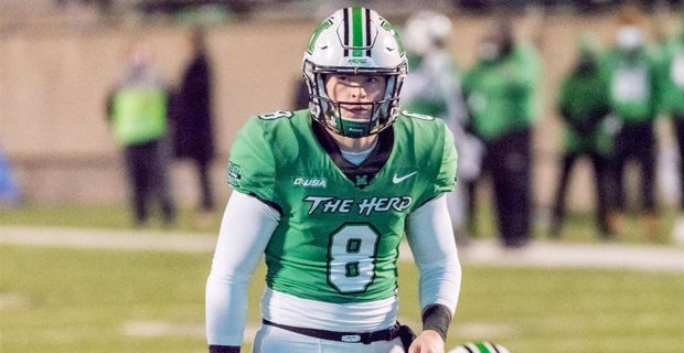 Marshall quarterback Grant Wells threw for two touchdowns and ran in three on his own against the North Texas Mean Green on Oct. 15 in Denton, Texas.