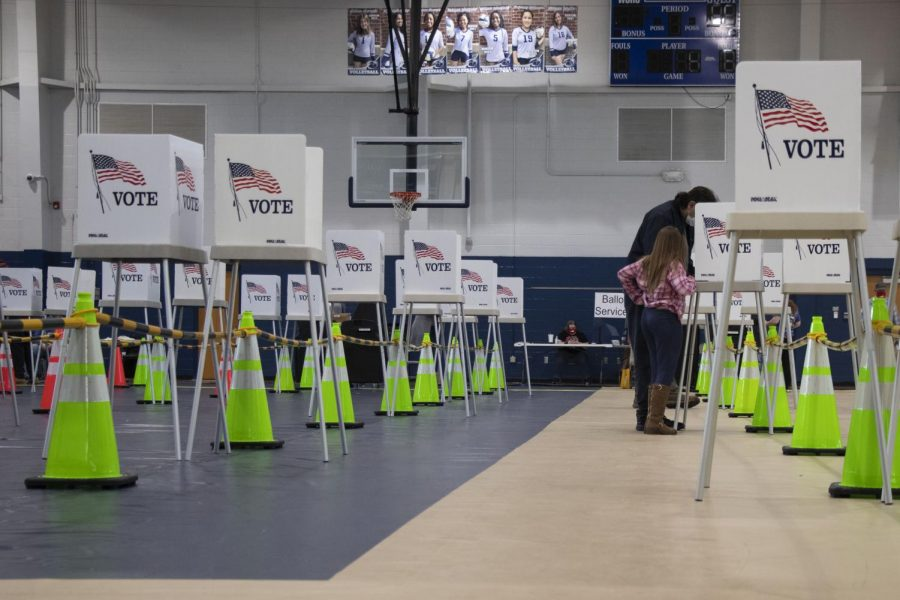 A voter fills out her ballot in the Warren Central High School gym on the afternoon of Nov. 3, 2020.