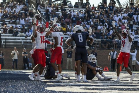 WKU freshman wide receiver Dakota Thomas (15) celebrates in the end zone after catching his first-ever collegiate touchdown against the ODU Monarchs on Oct. 16, 2021. WKU went on to win 43-20.