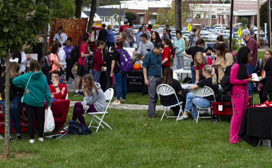 The front lawn of the Kentucky Museum bustles with different activities by department from Potter College of Arts and Letters for their annual Fall Festival on Oct. 19, 2021.