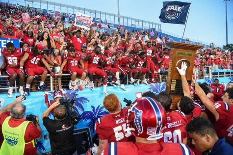 Florida Atlantic players celebrate the Don Shula Award with their fans after defeating Florida International 58-21 in the Shula Bowl in Boca Raton on October 2, 2021.