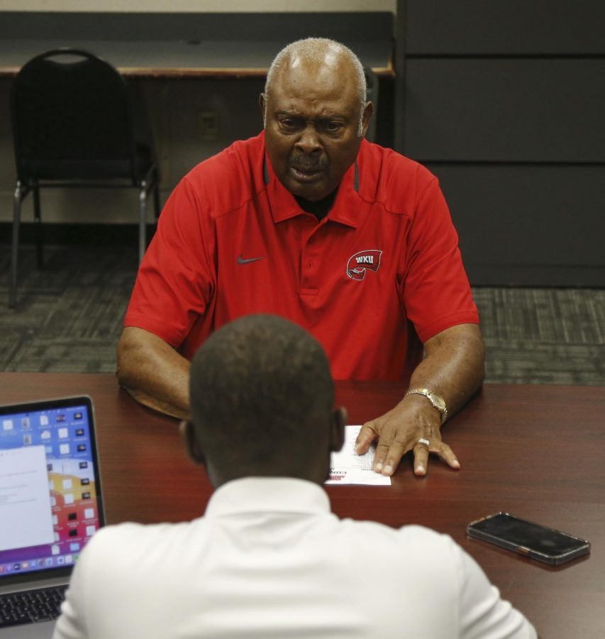 Former Western Kentucky University basketball player Clem Haskins is interviewed by Kaden Gaylord-Day in Diddle Arena on Oct. 6, 2021. Haskins, along with teammate Dwight Smith, became the first African-American athletes to integrate WKU's basketball program in the fall of 1963.