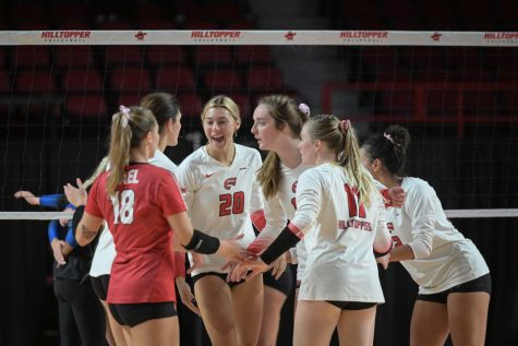 The WKU Hilltoppers celebrate after a point against the MTSU Blue Raiders on Friday, Oct. 15 of 2021 during a match WKU won 3-0 in Diddle Arena.