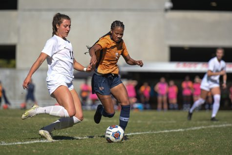 Lady Topper sophomore defender Ellie Belcher (11) and UTEP Miners junior forward Kam Fisher jockey for control of the ball during a match the Hilltoppers lost 2-0 on Sunday afternoon, Oct. 17 of 2021, at the WKU Soccer Complex.