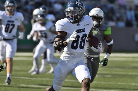 Rices August Pitre III runs a 35-yard reception from Wiley Green in the first quarter of the Owls win over UAB on Saturday, Oct. 23.