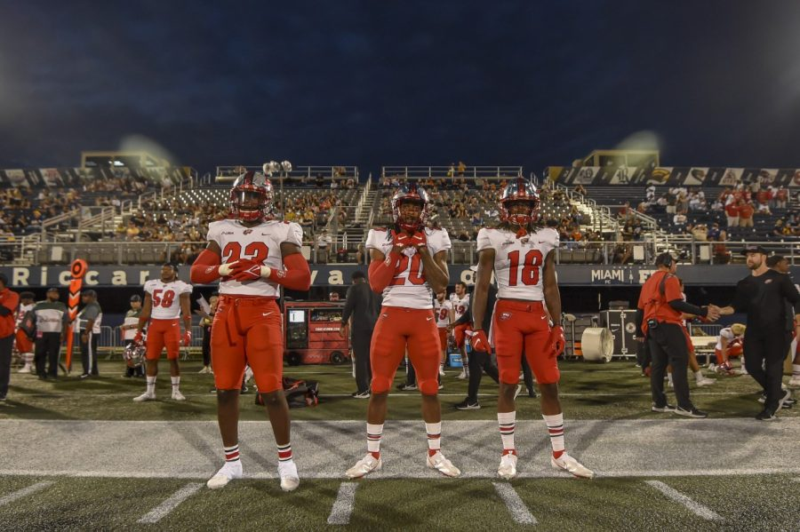 WKU redshirt linebacker Will Ignont (23), freshman running back Noah Whittington (20) and redshirt junior wide receiver Daewood Davis (18) stand at the ready on the sidelines during WKUs 34-19 victory over FIU in Miami, Florida on Oct. 23, 2021.